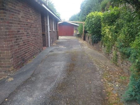 Fatigued driveway before